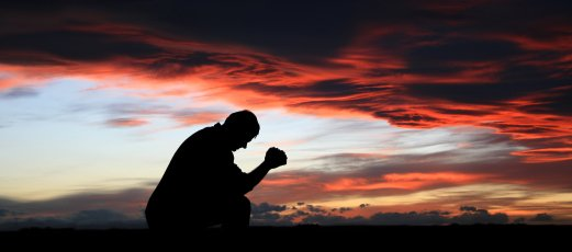prayer-kneeling-iStock_000004370993XSmall.jpg